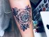rose_tattoo_blackwork_geometric_abstract_sketch_style_shading_arm_el_color_solido_lohmar_ingo_wirths.jpg